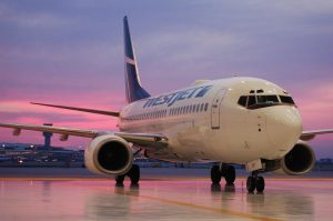 westjet-plane-sunset